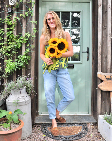 Stef outside her farmhouse cottage door