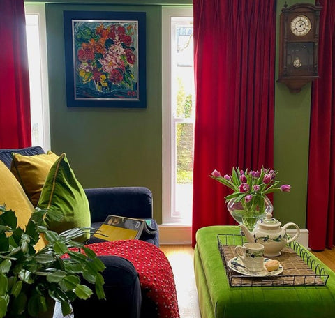 colourful red and green decor with grandfather clock