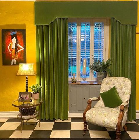 green velvet curtains and cushions