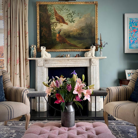 classic drawing room fireplace and oil painting