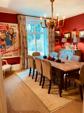 traditional country home dining room with Marylin Monroe movie poster