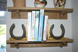 Image of Books on a Wooden Shelf with Horseshoe Bookends