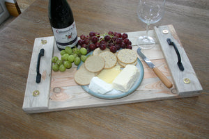 image of attractive supper tray with cheese, grapes and wine