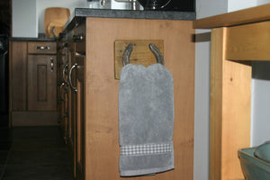 Image of country kitchen horseshoe towel holder with grey towel