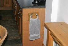 Load image into Gallery viewer, Image of horseshoe towel holder with towel