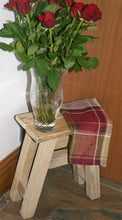 Load image into Gallery viewer, Natural wood traditional milking stool used as a side table with a vase of red roses on top