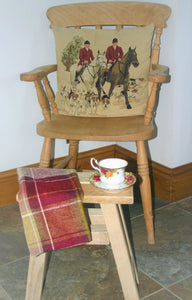 Country style image of traditional wooden stool with cup and saucer