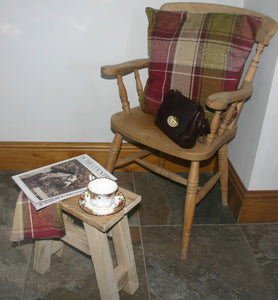Country style image of wooden kitchen chair with rustic wooden footstool