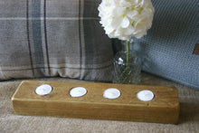 Load image into Gallery viewer, Image of rustic natural wood tealight candle holder with 4 tealights