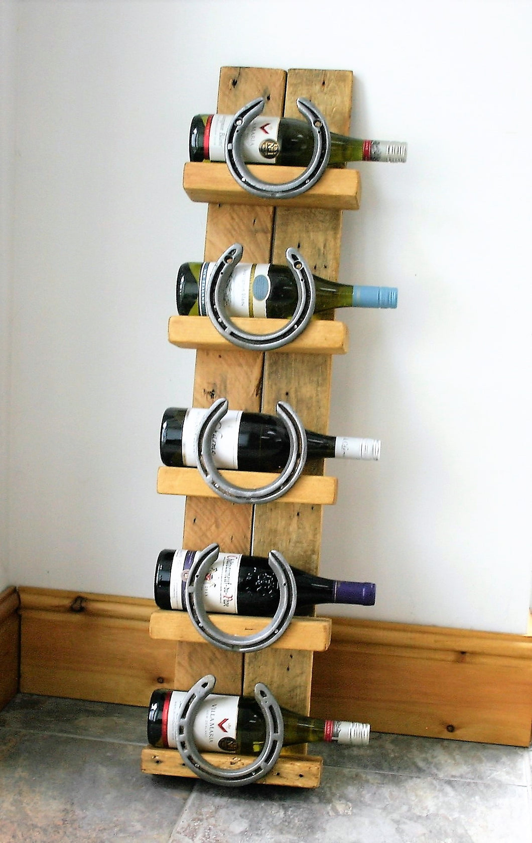 Image of Cheltenham Horseshoe Wine Bottle Display Stand With Bottles of Wine