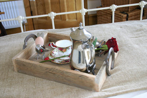breakfast in bed served on a tray with romantic red rose