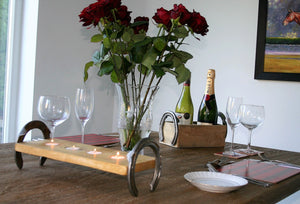 Horseshoe theme dinner table setting with horseshoe candle holder and Cheltenham bottle display holder