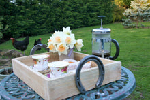 Load image into Gallery viewer, Coffee & Cake on a Wooden Horseshoe Handle Serving Tray in a Garden