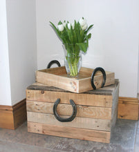 Load image into Gallery viewer, Image showing rustic horseshoe handle wooden storage chest with serving tray and flowers on top