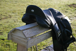 Wooden stand for storing saddle or saddles