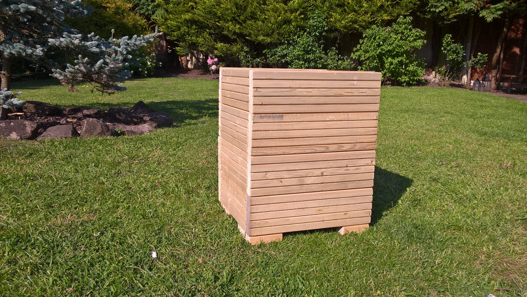 Large square wooden tub planter in garden
