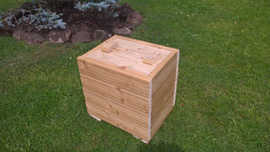 Wooden patio planter with lid for storage