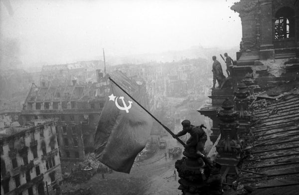 Raising a Flag over the Reichstag - one of the most famous photos of World War II was staged by Soviet photographer Yevgeny Khaldei.
