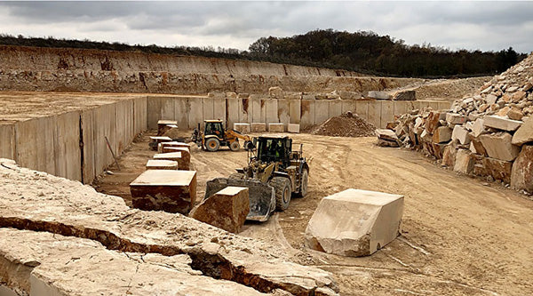 Limestone quarry with block moving equipment