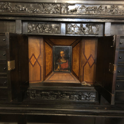 Cabinet for displaying religious artifacts