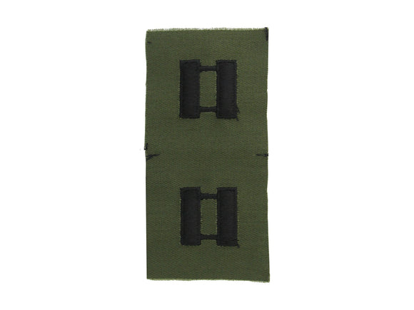 black embroidery on green subdued army fabric