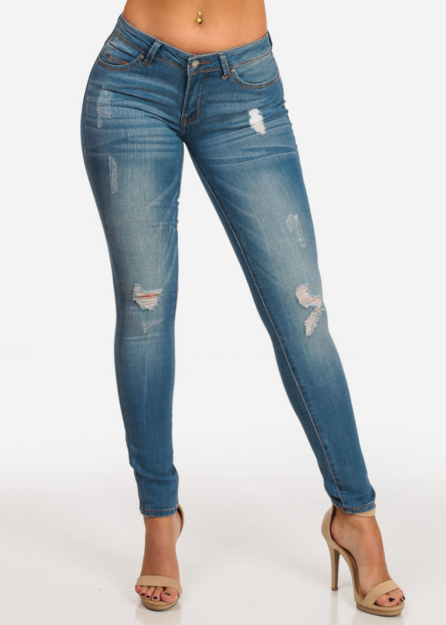 9dea0fe183e Stylish Trendy Mid Rise Med Wash 1 Button Distressed Skinny Jeans. Double  tap to zoom