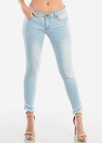 Image of Women's Junior Ladies Casual Cute Low Rise 1 Button Distressed Light Wash Skinny Jeans