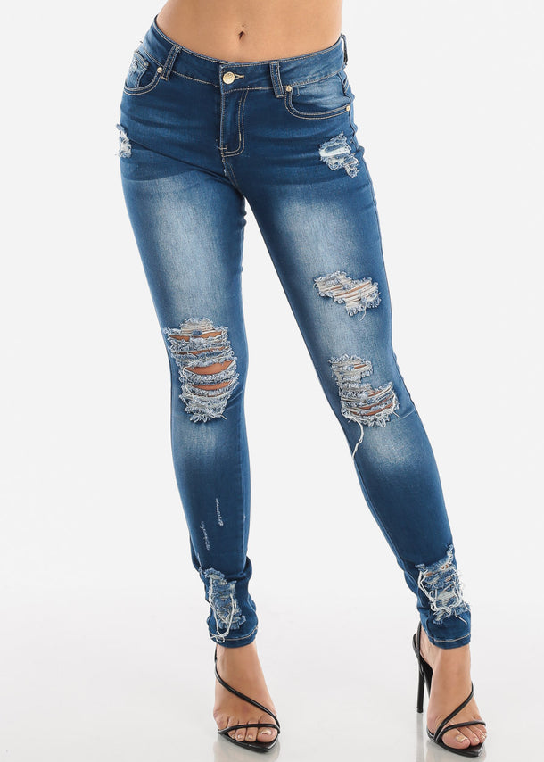 Ripped Mid Rise Med Wash Skinny Jeans
