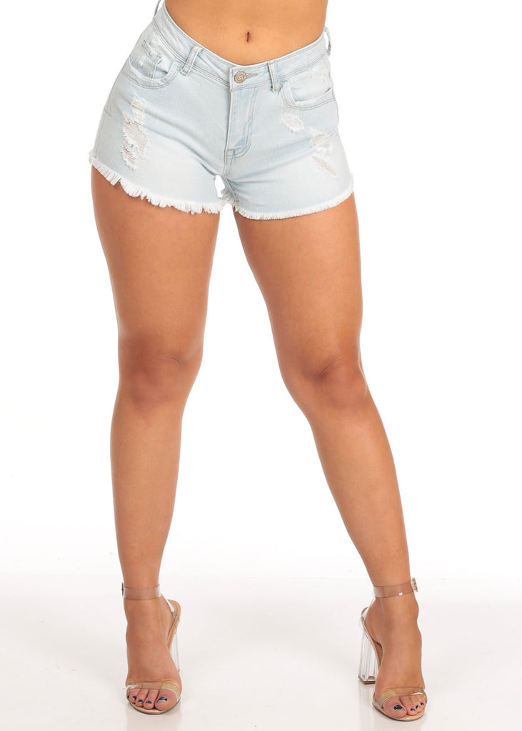 Mid Rise Light Wash Distressed Raw Hem Denim Shorts