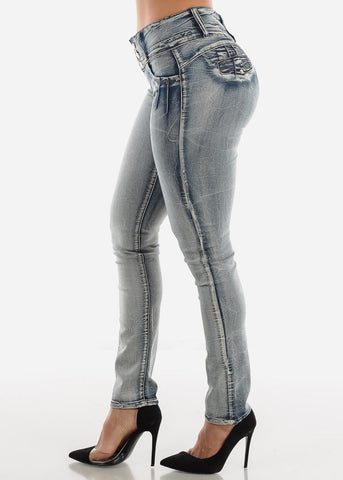 Mid Rise Levanta Cola Faded Skinny Jeans