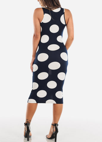 Image of Sleeveless Navy Polka Dot Bodycon Midi Dress