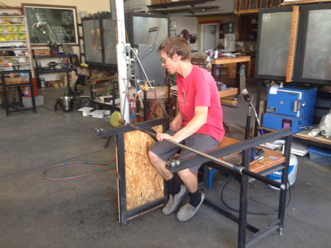 John Gibbons glass blowing sculpting starfish on a bench