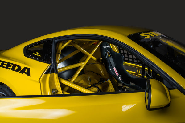 Steeda Q500R interior with roll cage and Corbeau race seats