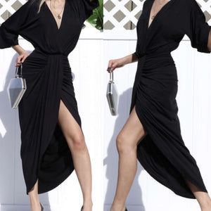black jersey midi dress with front slit and sleeves