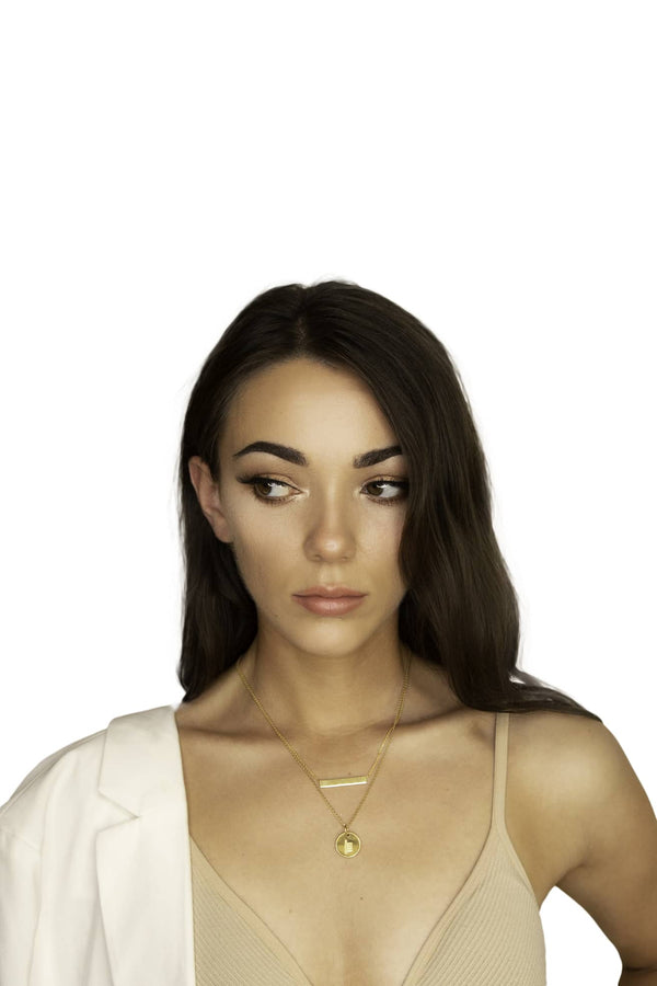 girl wearing gold ogham necklace