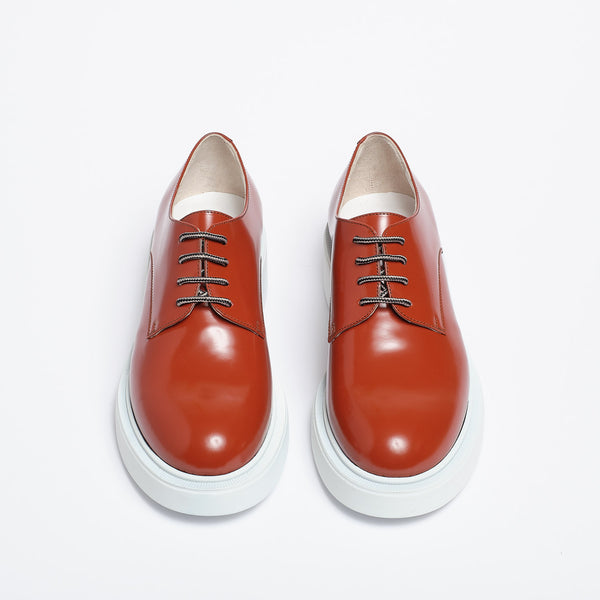 Tina Derby carmine red