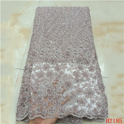 Image of 2019 High Quality Tulle Lace Fabric Handmade French Mesh African Lace Fabric Embroidered With Stone Lace For Party Dress HX2185