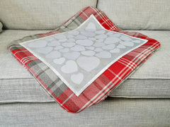 Wedding guestbook quilt draped over chair