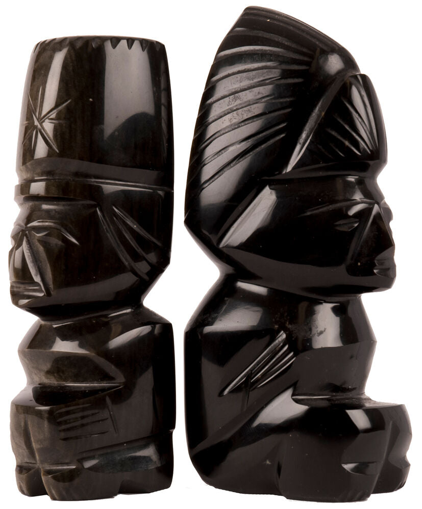 A pair of not identical modern Aztek deities, carved from obsidian
