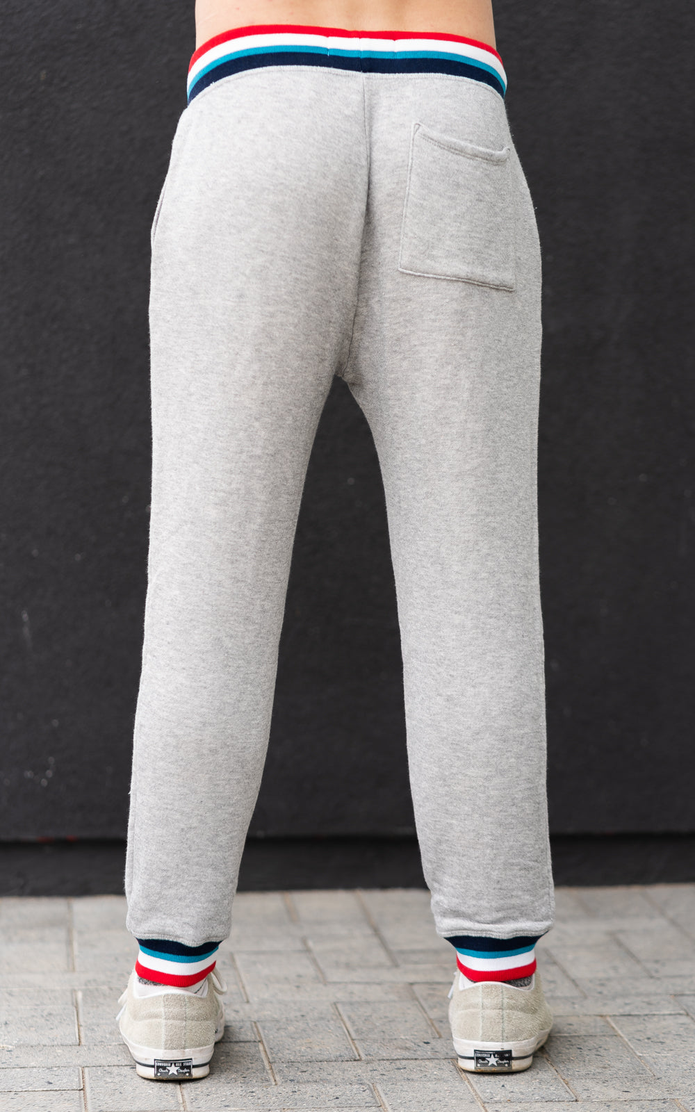 Sol Angeles Sweatpants in grey with red, white, and blue bands
