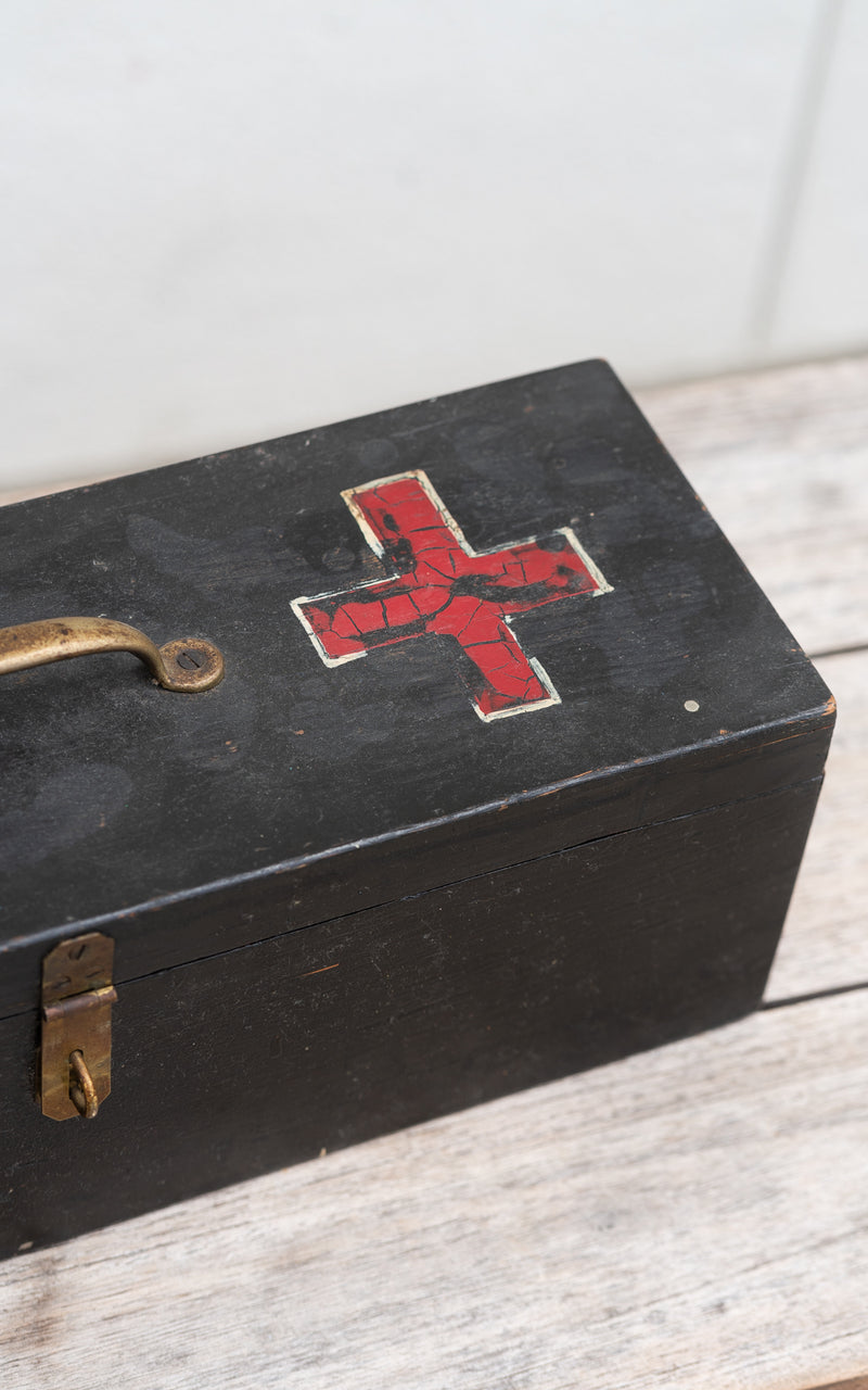 Tool Box in wood with red crosses