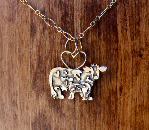 handmade sterling silver mother cow and her male calf necklace