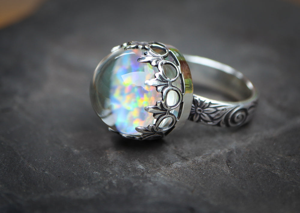 A borosilicate handmade glass opal ring with sterling silver band.
