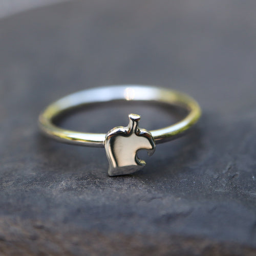 Animal Crossing dainty sterling silver handmade ring shown on a piece of dark grey slate.