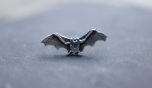 Load image into Gallery viewer, One little sterling silver bat earring that was handmade by The Striped Cat Metalworks