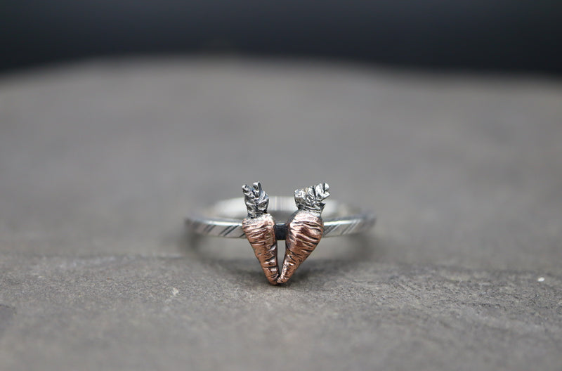 A hand carved copper and silver carrot ring.