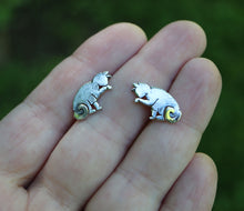 Load image into Gallery viewer, Small handmade silver cat studs pictured in a hand to show size made by The Striped Cat Metalworks