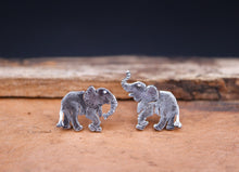 Load image into Gallery viewer, Mismatched elephant sterling silver earrings. One elephant has his trunk up and the other elephant has his trunk down.