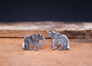 Mismatched elephant sterling silver earrings. One elephant has his trunk up and the other elephant has his trunk down.