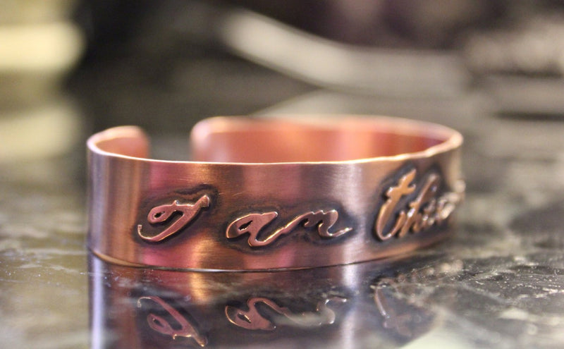 "Another side view of the ""I am their voice"" copper handmade cuff bracelet."